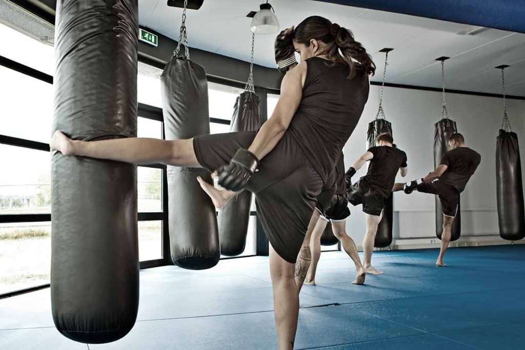 Group training on kicking heavy bags