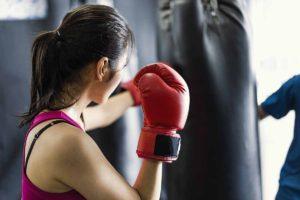 Woman boxing heavy bag