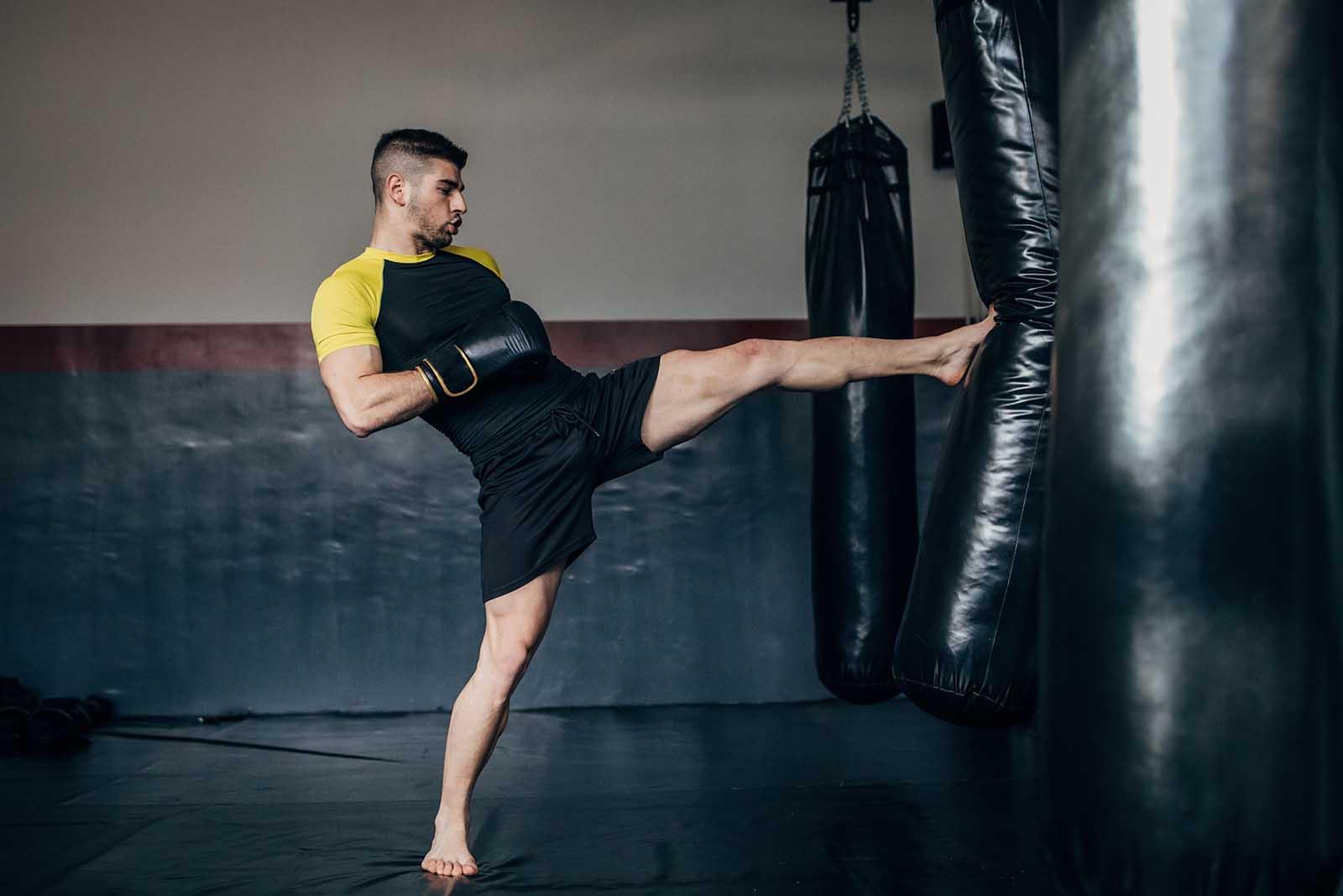 Man Kicking heavy bag
